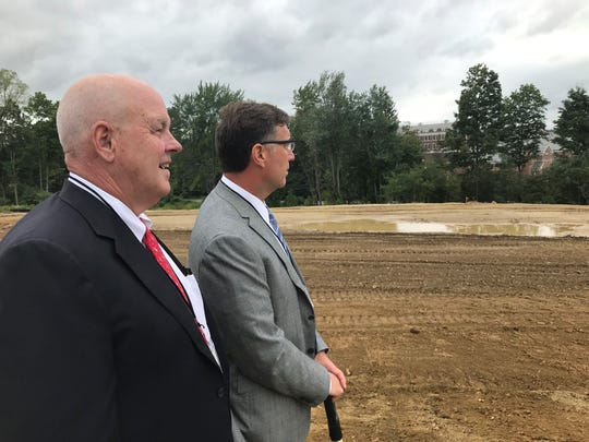 Lance Shaner, chief executive officer with The Shaner Hotel Group, and Tom Mulroy, chief executive officer at T-Rex Capital Group, overlook the future site of Bellefield at Historic Hyde Park.