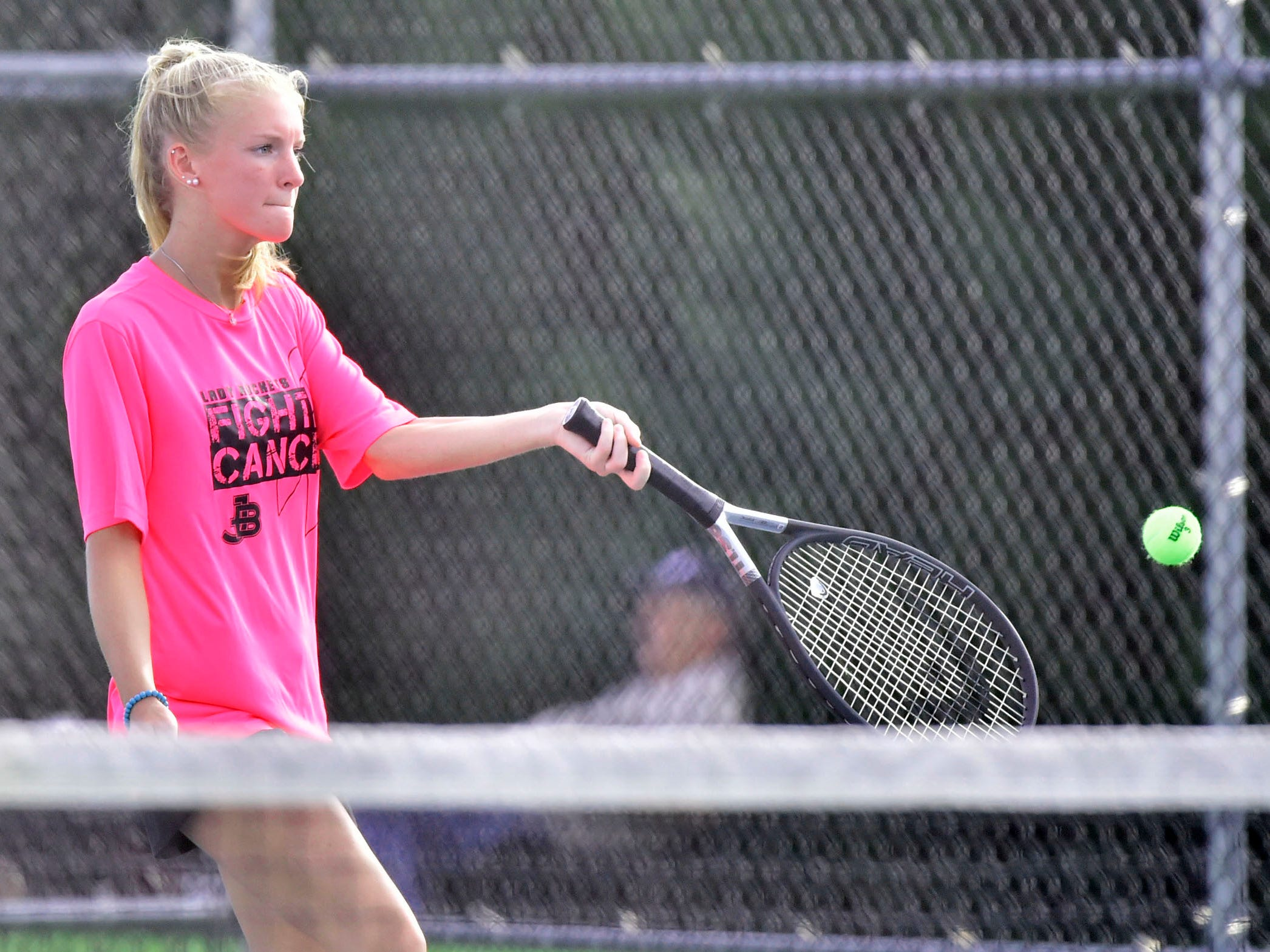 Ella Jones of James Buchanan plays a match against Middletown's Angie Torres during tennis action Thursday, September 20, 2018.
