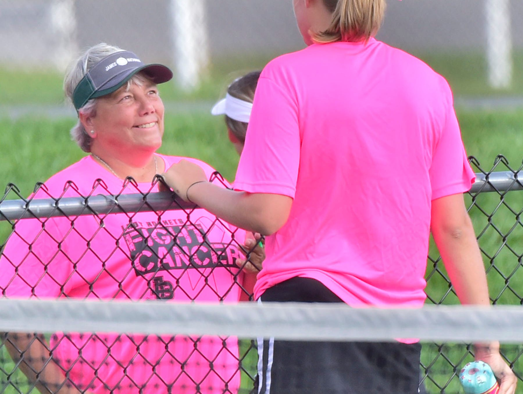 James Buchanan tennis coach Terri Beegle, left,  talks to her no. 1 player Maggie Strawoet during a break on action against Middletown Thursday, September 20, 2018.