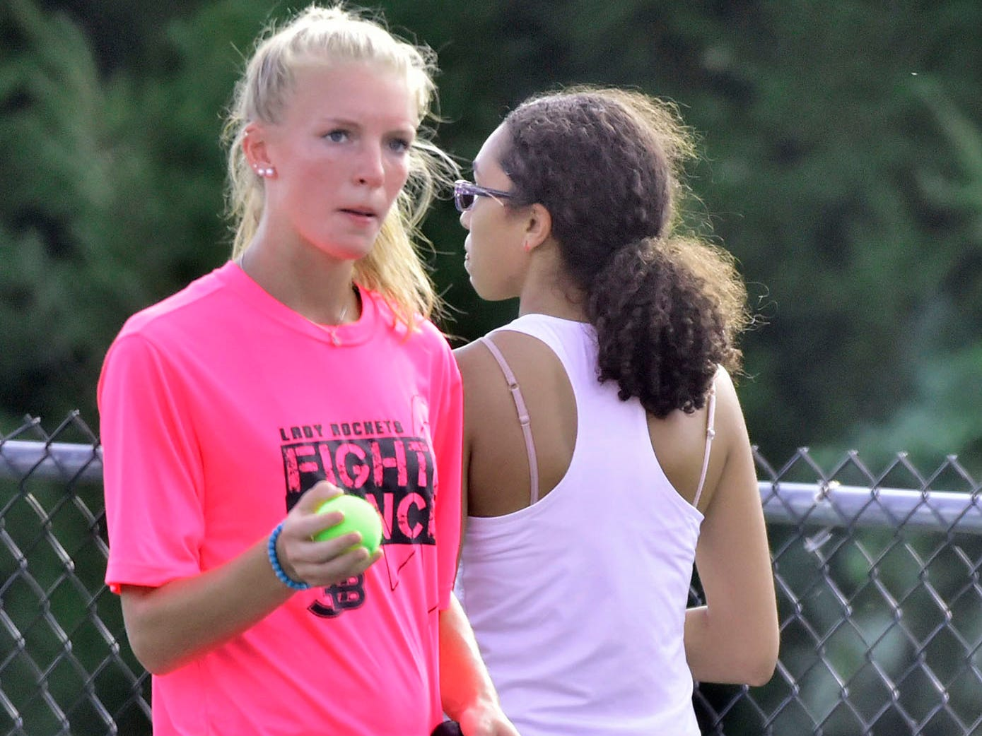 Ella Jones, left, of James Buchanan finishes a set against Middletown's Angie Torres during tennis action Thursday, September 20, 2018.