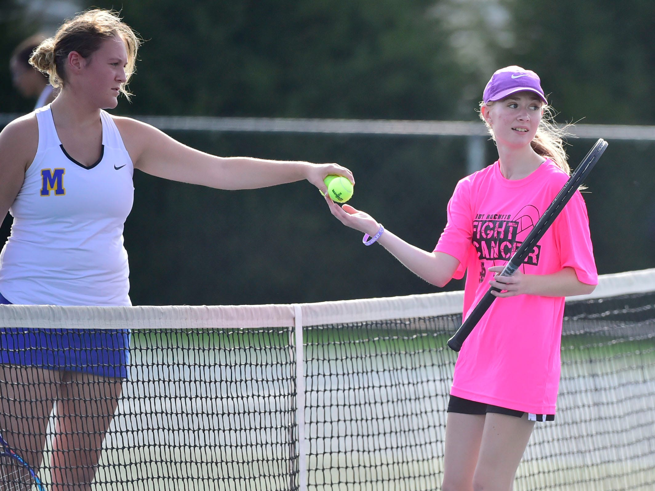 Amber Clark of James Buchanan plays a match against Middletown's Anna Buffington, left, during tennis action Thursday, September 20, 2018.