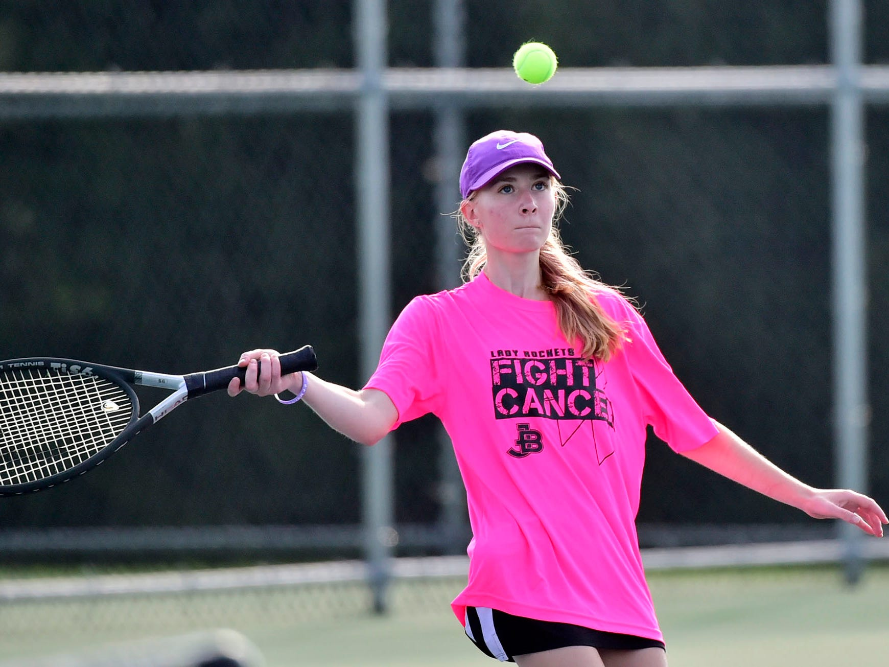 Amber Clark of James Buchanan plays a match against Middletown's Anna Buffington during tennis action Thursday, September 20, 2018.