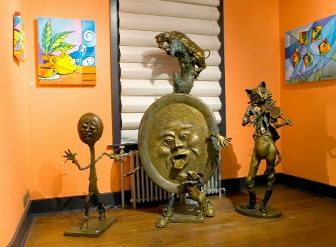 We now go through pictures of Ophelia Chambliss' work, starting with this 2005 exhibit. Here, the work of two of the most prominent York County artists of this generation come together. Ophelia Chambliss' paintings surround sculptures of Lorann Jacobs.