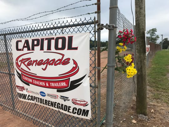 A make-shift memorial hangs on the fence at BAPS Motor Speedway in honor of Greg Hodnett.