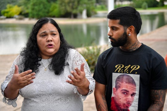 On the third anniversary of Erik Miranda's shooting death, his friends and family gather at Kiwanis Lake to honor him. Olga Davis, Erik's cousin, (left) and Jack Padro, Erik's brother (right) share his memory, Thursday, September 20, 2018.