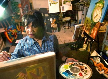 We're still in 2005, and Ophelia Chambliss works in the basement of her Manchester Township home. To the right is a painting of the clock tower at the intersection of West Market and Beaver streets.