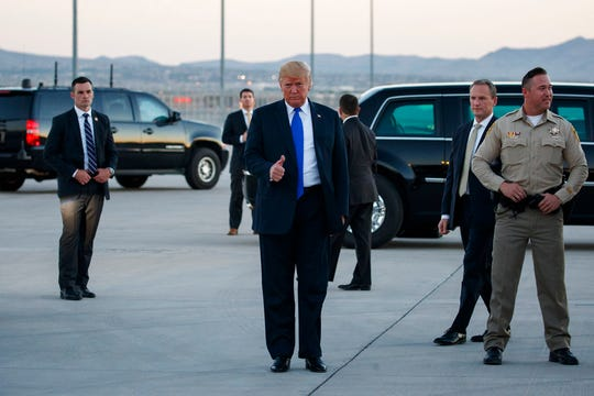 President Donald Trump gives a thumbs-up as he arrives at McCarran International Airport for a campaign rally, Thursday, Sept. 20, 2018, in Las Vegas.