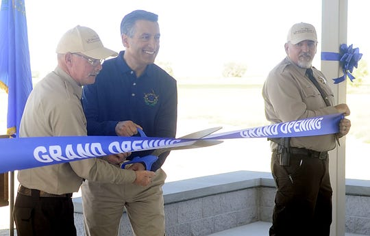 Gov. Brian Sandoval cuts a ribbon during the official opening of Walker River State Recreation Area.