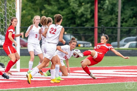 Payton VanMiddlesworth (22 in red shorts) is among the state's leaders with 29 goals this season.