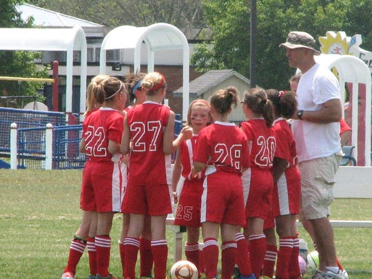 Neal VanMiddlesworth, right, coached several of the current Richmond girls soccer players during their youth soccer days.