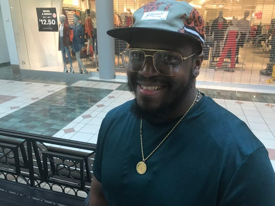 Khalil Womack waited in line to see the new Apple store.