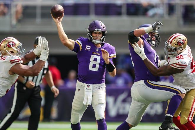 Minnesota Vikings quarterback Kirk Cousins (8) throws during the fourth quarter against San Francisco 49ers at U.S. Bank Stadium.