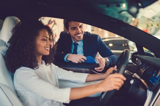 Mixed Race Woman Enjoying New Car
