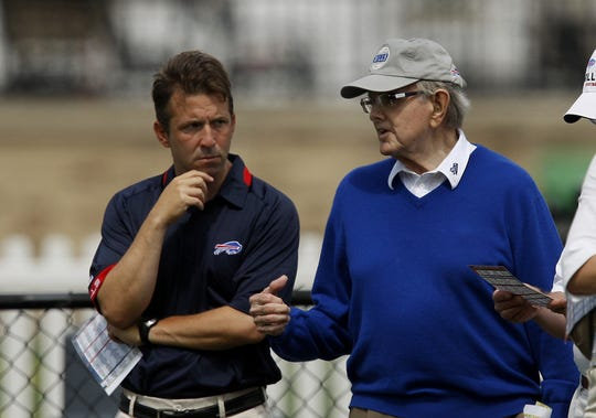 Ralph Wilson, right, founder and late owner of the Buffalo Bills, watches a team practice with Russ Brandon during training camp in 2009.