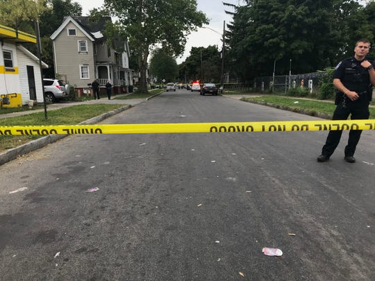 Rochester police technicians arrive at the scene of a double shooting on Wilkins Street in September 2018.