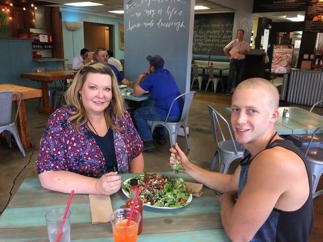 Angela Jones, left, and son Christopher Baker split a salad at Madayne on Eureka Way in west Redding.