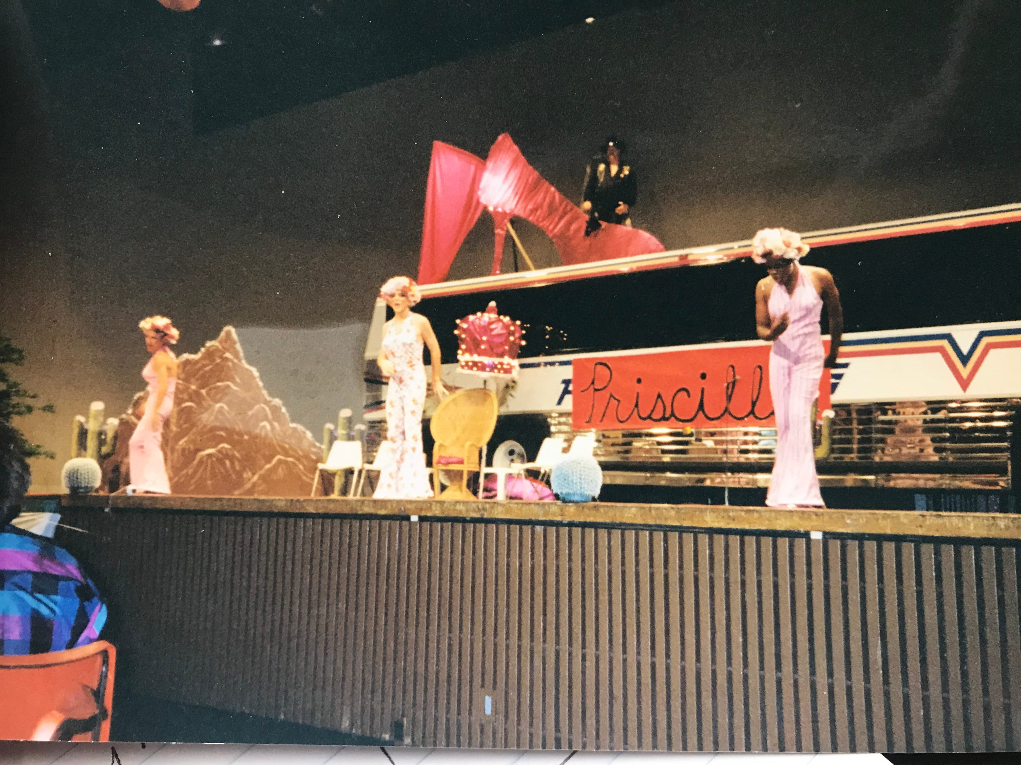 "Hinton stands on top of the bus for his ""stepping down"" party, which was to the theme of ""The Adventures of Priscilla, Queen of the Desert."""