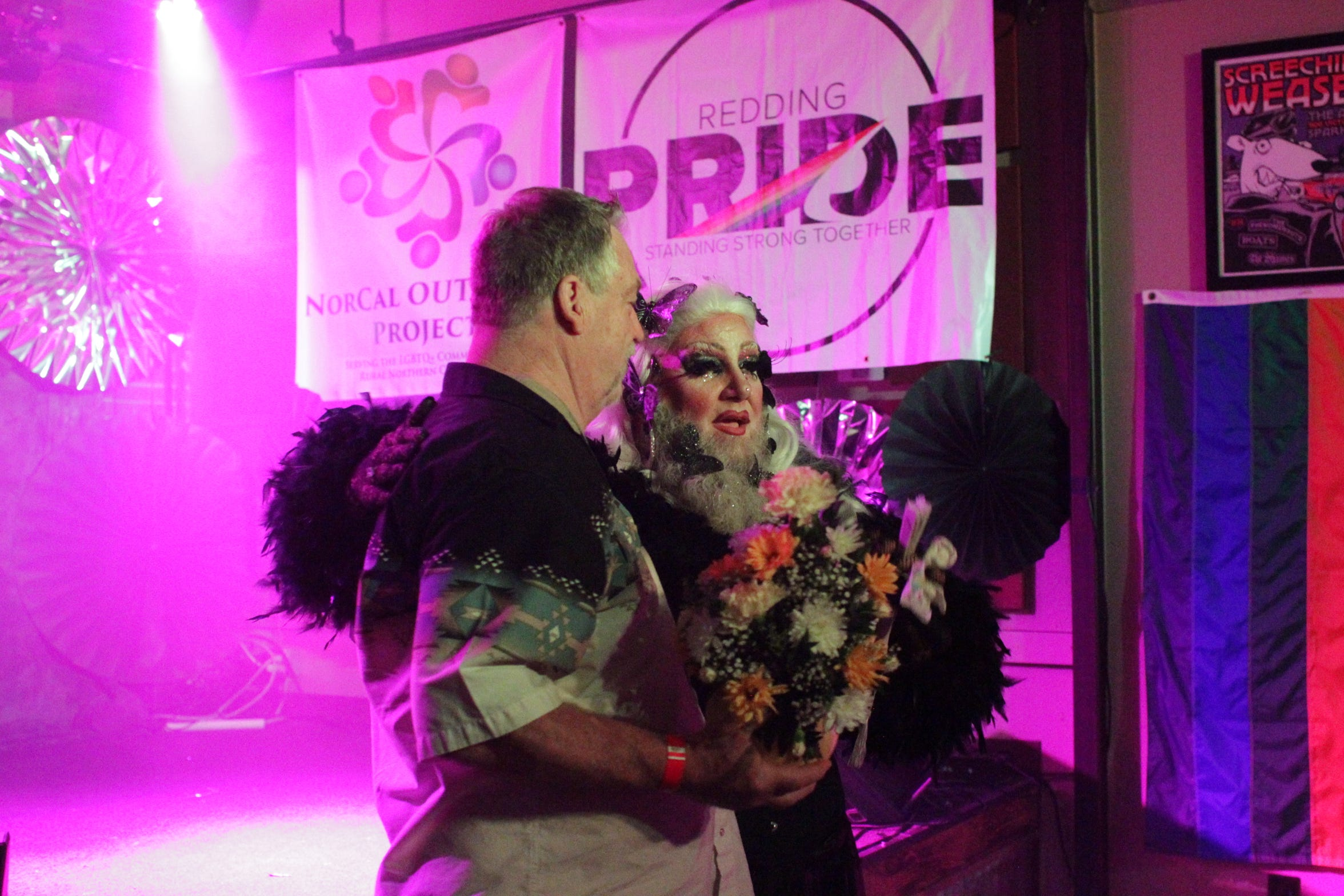 "Tom Hinton is honored by ""Mama Troy"" for his contribution to the drag community."