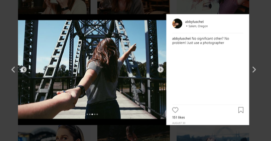 A screenshot of entertainment reporter Abby Luschei's Instagram. She is photographed at the Union Street Pedestrian Bridge.
