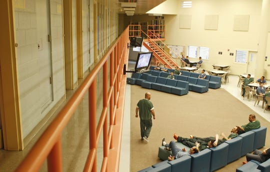 Inmates outside of their cells in the G pod at the Marion County Jail, Oct. 19, 2011.