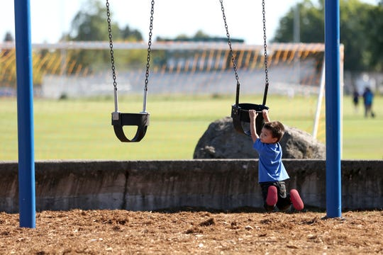 Ryan Richter, 6, plays on the swings at McKay School Park on Thursday, Sep. 20. Salem Parks Foundation is raising money to purchase the park brand new playground equipment.