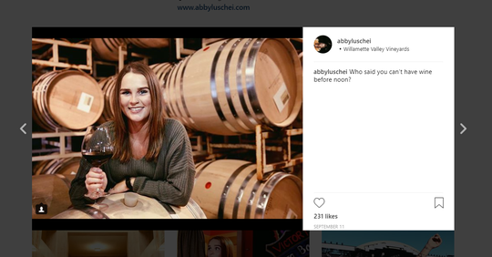 A screenshot of entertainment reporter Abby Luschei's Instagram. She is photographed at Willamette Valley Vineyards.