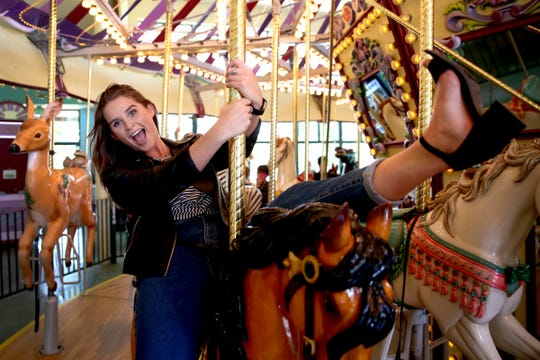 Statesman Journal entertainment reporter Abby Luschei rides the Riverfront Carousel as one of her top Instagram-friendly spots in Salem on Wednesday, Aug. 29, 2018.