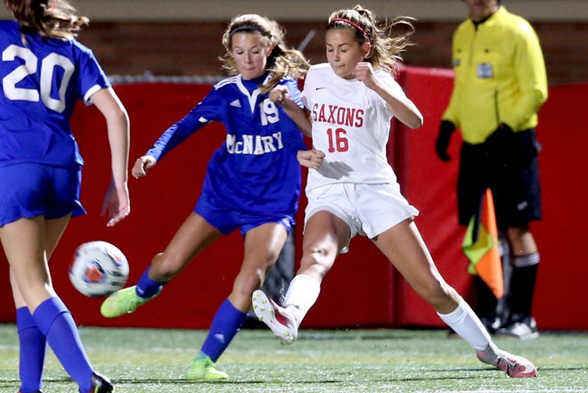 McNary's Olivia Purkey (19) and South Salem's Hailey Ralls (16) both stretch out for the ball in the McNary vs. South Salem girls soccer game at South Salem High School on Thursday, Oct. 19, 2017.