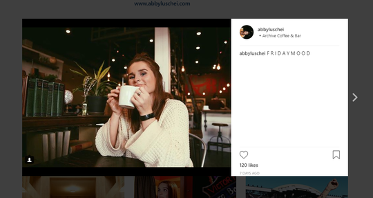 A screenshot of entertainment reporter Abby Luschei's Instagram. She is photographed at Archive Coffee & Bar.