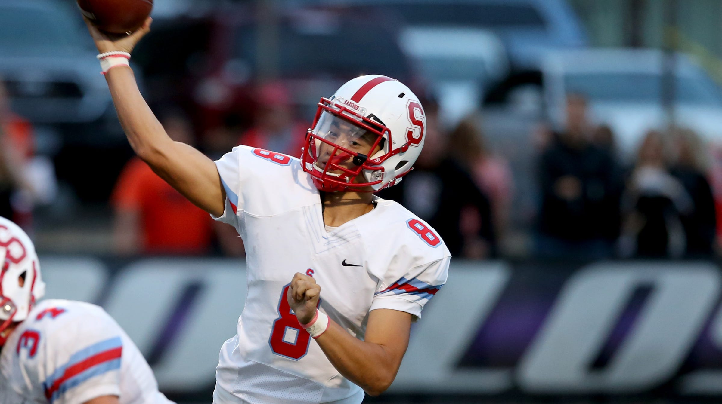 South Salem's Elijah Enomoto-Haole (8) passes the ball in the first half of the South Salem vs. Sunset football game at Sunset High School in Beaverton on Friday, Sep. 7, 2018.
