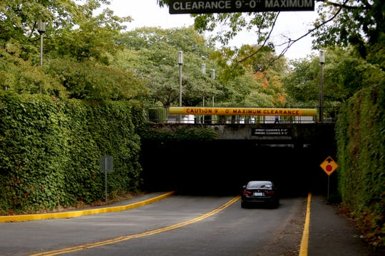The road to the underground parking structure at the Capitol Mall in Salem on Friday, Sep. 21, 2018. State officials say roots from cherry blossom trees above the garage might be causing damage. If so, the trees will need to be removed.