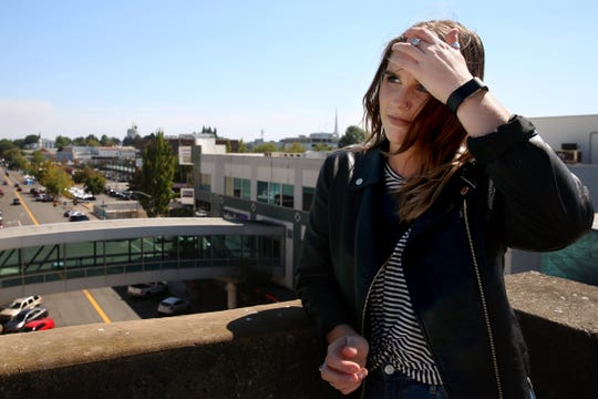 Statesman Journal entertainment reporter Abby Luschei visits the top of a parking garage with a downtown view as one of her top Instagram-friendly spots in Salem on Wednesday, Aug. 29, 2018.