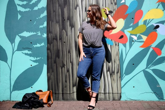 Statesman Journal entertainment reporter Abby Luschei visits a mural at Chemeketa St. NE in downtown as one of her top Instagram-friendly spots in Salem on Wednesday, Aug. 29, 2018.
