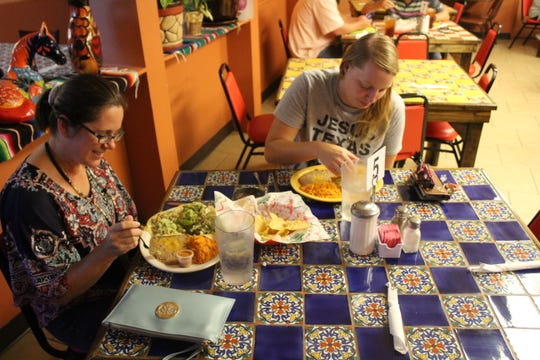 Victoria Norrell and Amanda Bragg enjoying lunch at Tacos OJ #2, 1219 W. Beauregard Ave.
