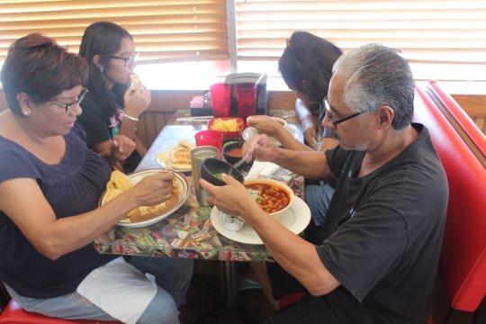 The Perez Family enjoys lunch at The Corner Stop #2, 1302 N Chadbourne St.