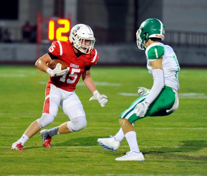 Sonora's Dylan Taylor tries to evade Wall's Cameron Barnes during their football game Thursday, Sept. 20, 2018, in Sonora.