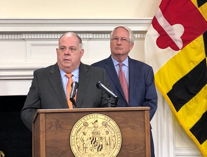 Maryland Gov. Larry Hogan and Maryland Insurance Commissioner Al Redmer announce lower premiums for healthcare plans at a news conference on Friday, Sept. 21.