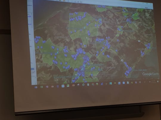 A map shows service areas for broadband company NeuBeam on Virginia's Eastern Shore, during a meeting at Eastern Shore Community College in Melfa, Virginia on Thursday, Sept. 20, 2018.