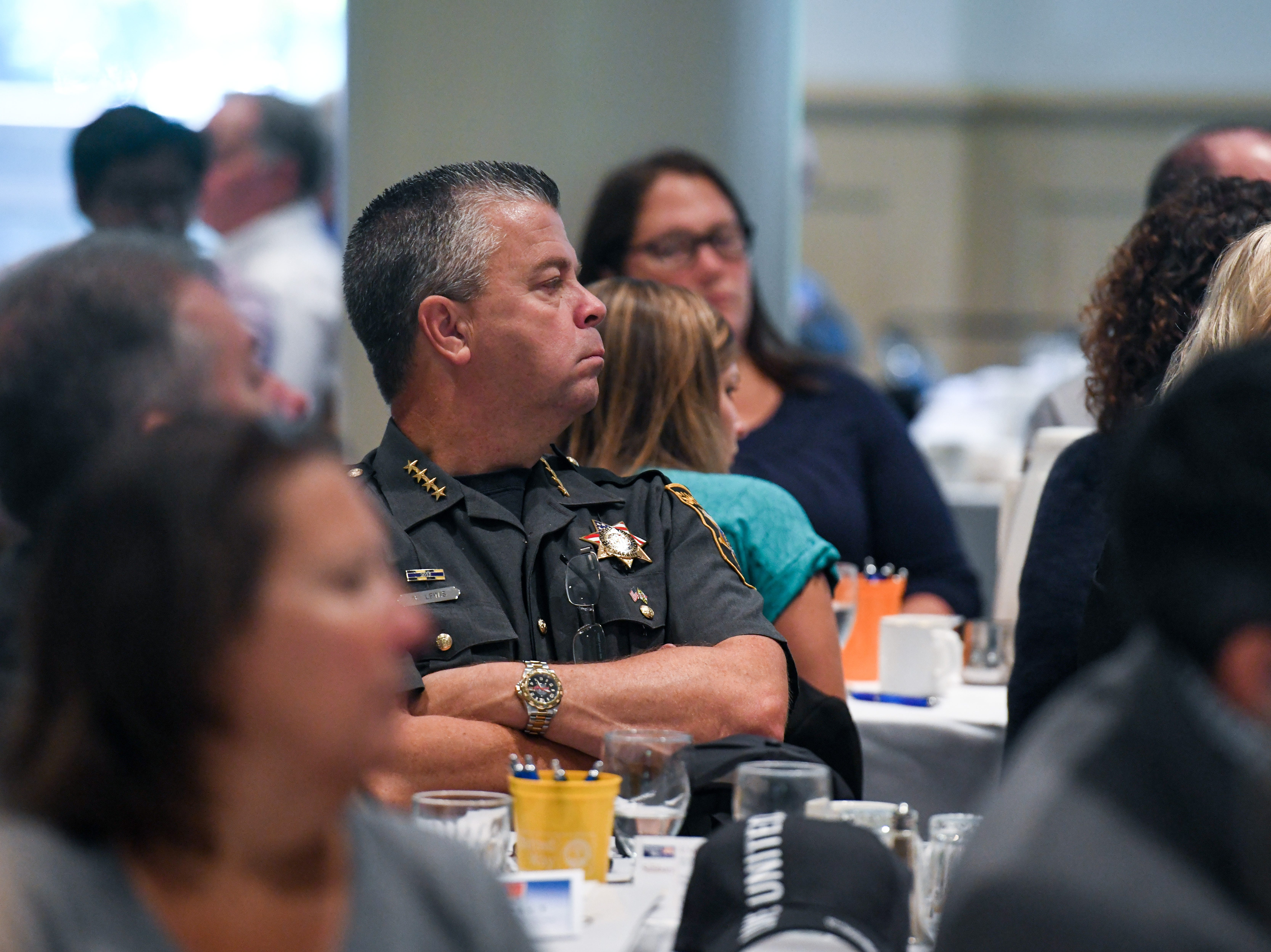 Wicomico County Sheriff Mike Lewis watches a speech at the United Way campaign kick-off breakfast at Salisbury University on Friday, Sept 21, 2018.