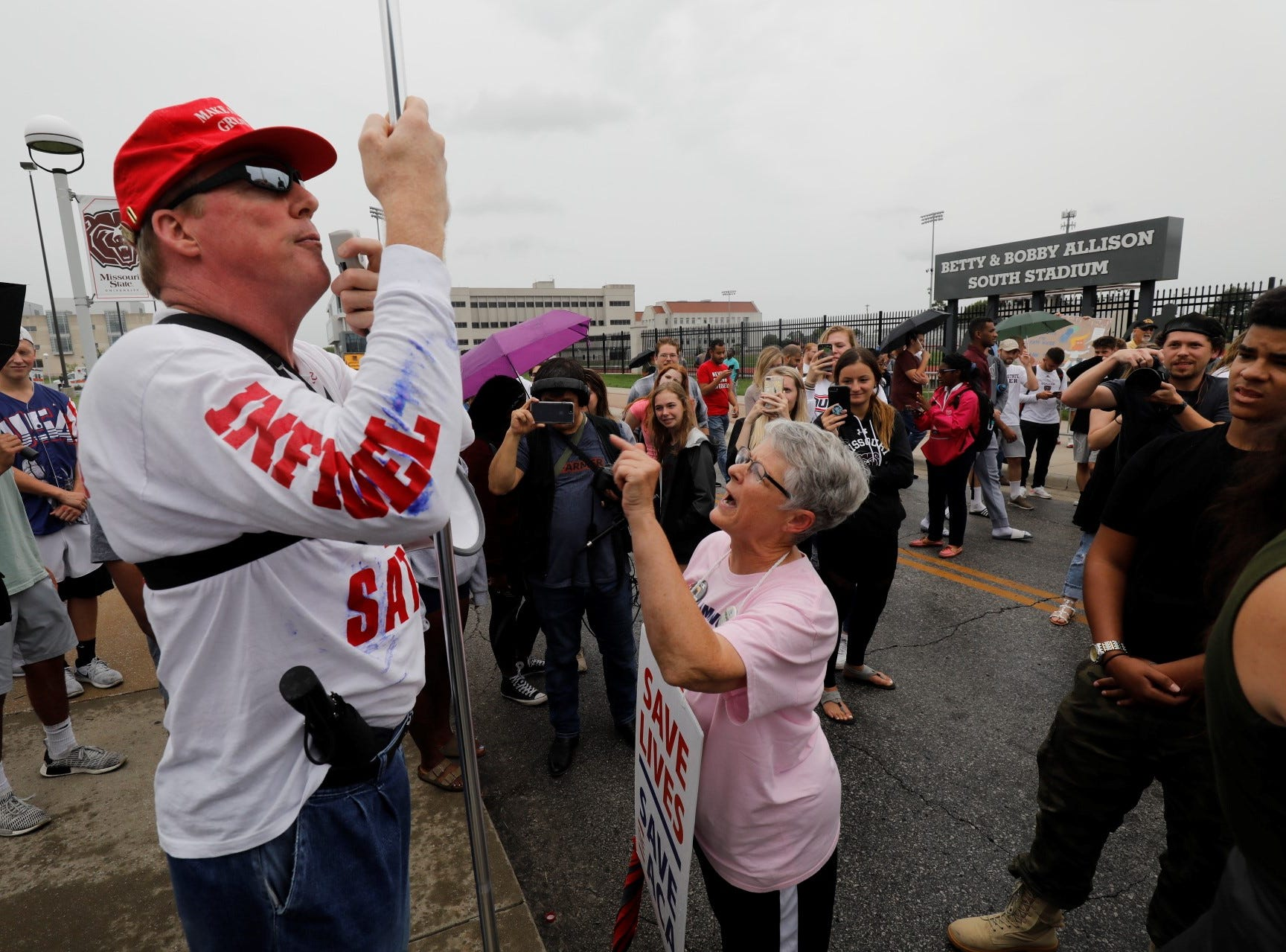 A vocal Trump supporter, left, hurled insults at the Trump protesters and incites their anger Friday, Sept. 21, 2018 outside JQH Arena in Springfield.