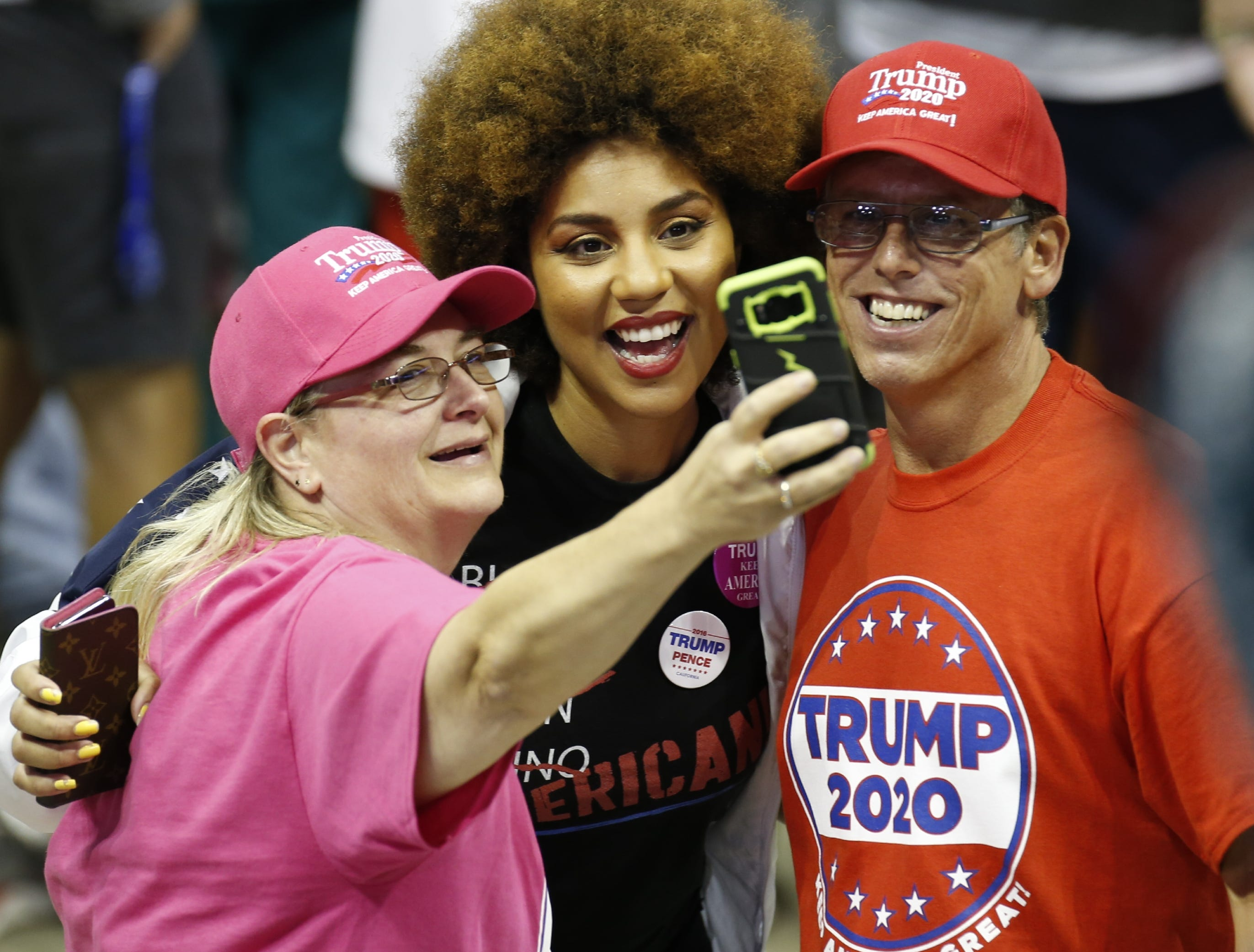 Supporters of President Trump wait for his rally to begin at JQH Arena on Friday, Sept. 21, 2018.