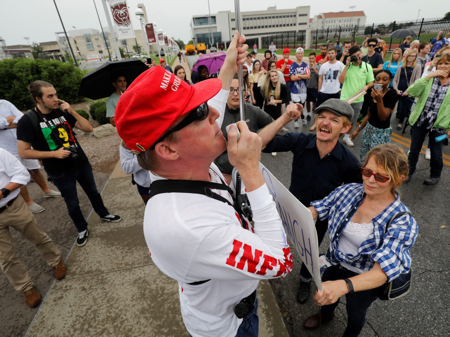 Trump supporters and protesters clash outside JQH Arena in Springfield on Friday, Sept. 21, 2018.