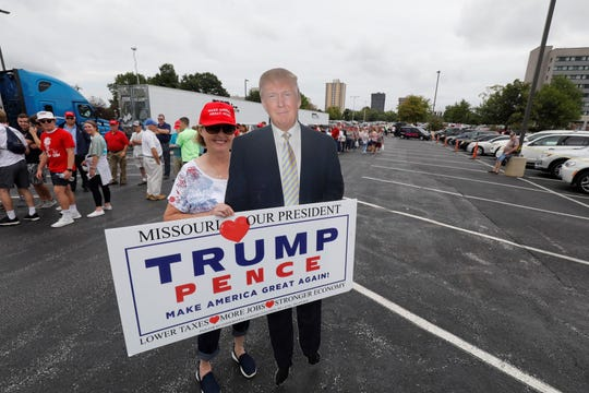 Brenda Rounds, Springfield, poses with a cutout of President Trump outside JQH Arena in Springfield on Friday, Sept. 21, 2018.