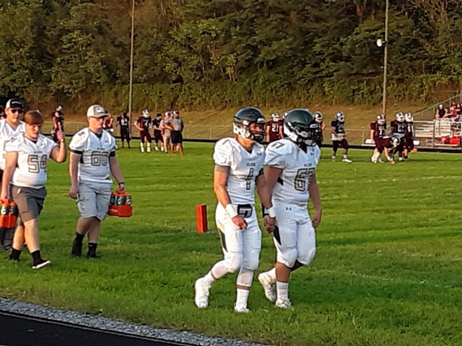 Wilson Memorial's Bryce Norman (1) and Cameron Sprouse (67)  walk to the field before the start of the Hornets' game at Luray Friday night.