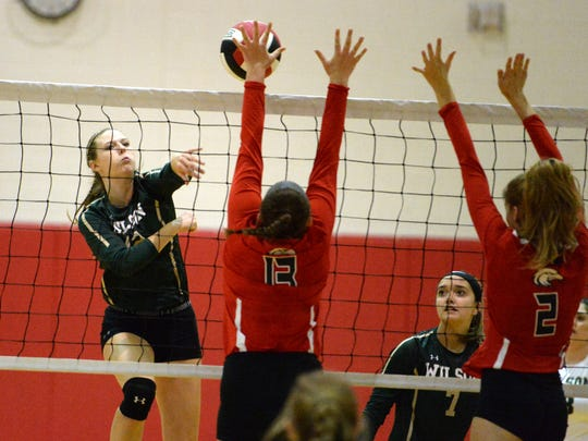Wilson Memorial's Paris Hutchinson works to get the ball over the East Rock defense Thursday. Hutchinson had 17 kills in Wilson's win.