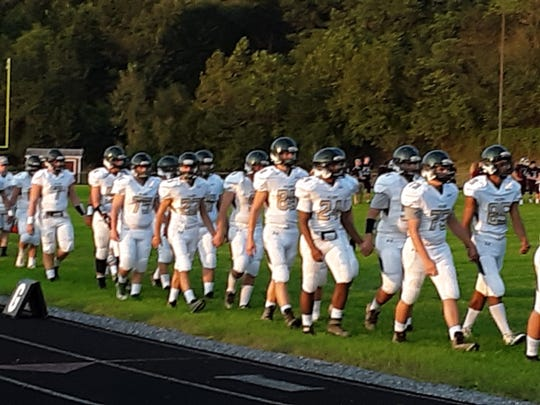 Wilson Memorial players take the field prior to Friday night's game at Luray.