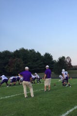 Waynesboro's kicker Sean Fridley (4) works on extra points before Friday night's game at Turner Ashby.