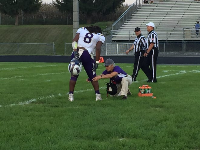 Waynesboro's Alijah Braxton gets some last minute adjustments before the start of Friday night's game at Turner Ashby.