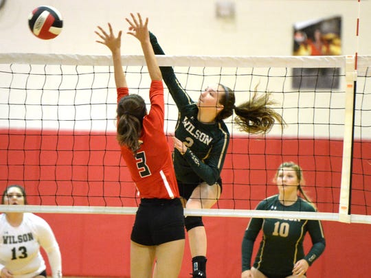 Wilson Memorial's Cassidy Davis gets the ball past the outstretched arms of East Rock's Kayla Rhodes Thursday night.