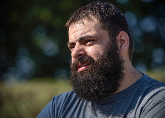 Aaron Firkus talks about losing 200 pounds and running a half-marathon Saturday, Sept. 15, at Heritage Park in St. Cloud.